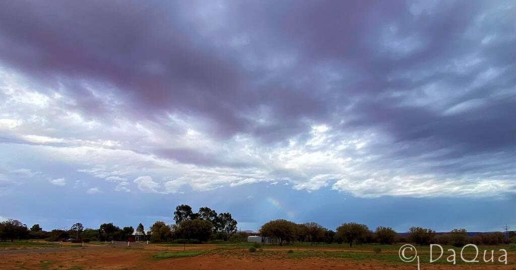 Rainbow beckoning under a cloudy sky © DaQua