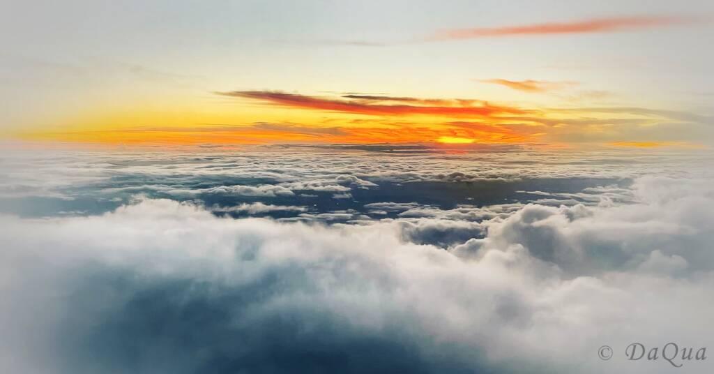 Aerial sunrise above the clouds by Da Qua