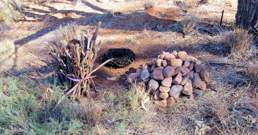 A Pile of Stones, A Bundle of Sticks & Black Gold, Artist Sue Taylor - (stones, sticks, roo poo and string)