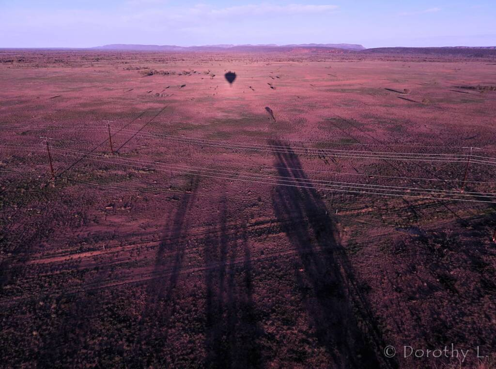 Fingers reaching for the balloon, Central Australia