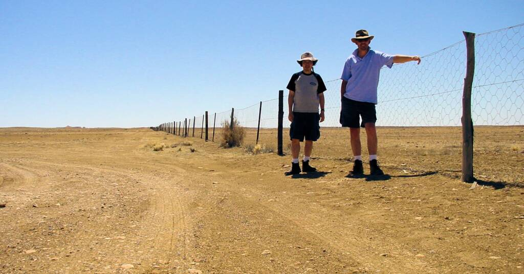 Dog fence passes by The Breakaways in South Australia