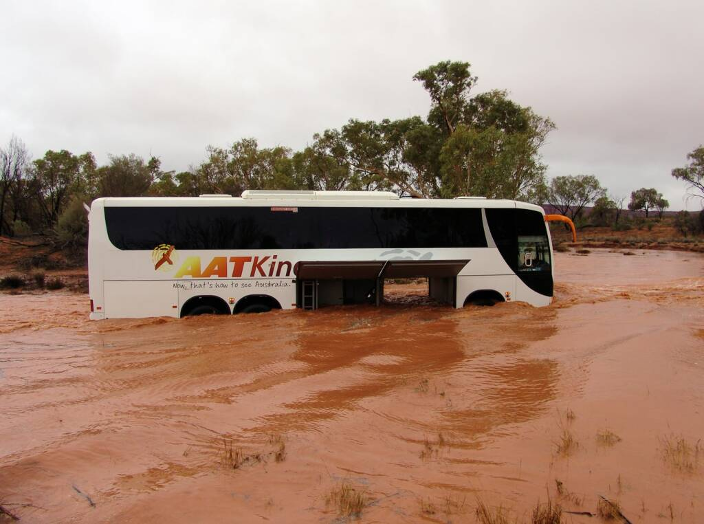 Traversing across the flooded Kings Creek - Watarrka National Park