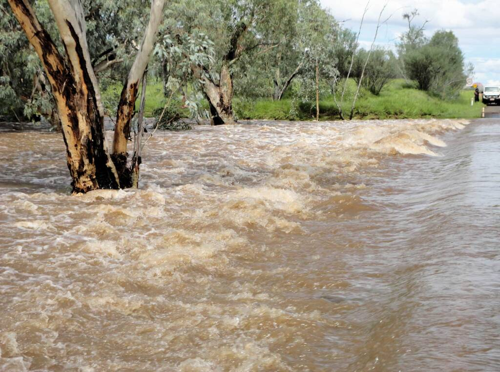 Roe Creek flowing over Larapinta Drive, Alice Springs, 19 Mar 2011