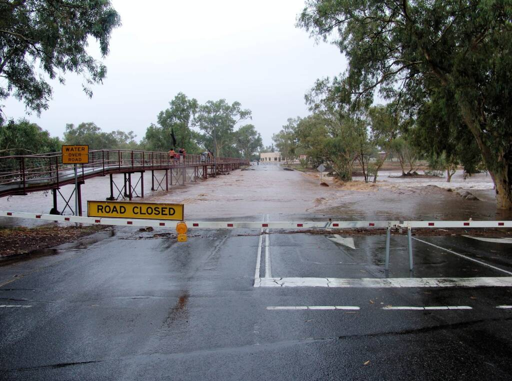 Road closed as water flows over and under Undoolya Road, Todd River, Alice Springs, 9 Jan 2010