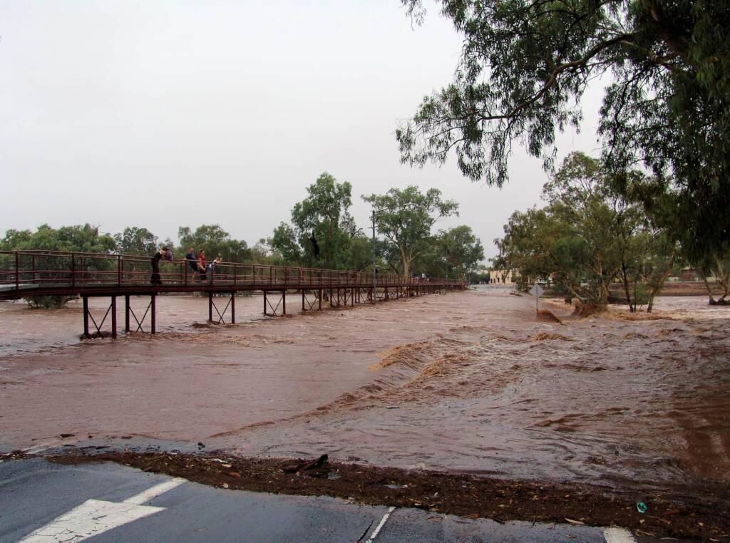 Water flowing over Undoolya Road causeway and under the footbridge, Todd River, Alice Springs, 9 Jan 2010