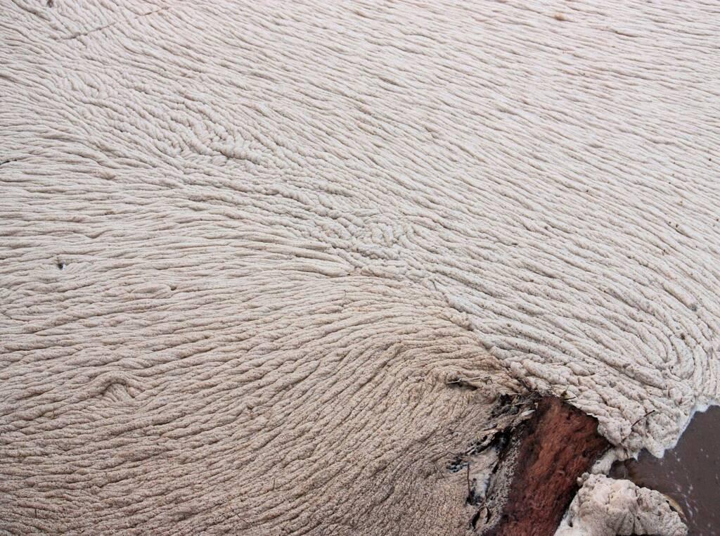 Foam on Todd River, north side of the Wills Terrace / Undoolya Road Main Causeway, Alice Springs, 23 Feb 2010