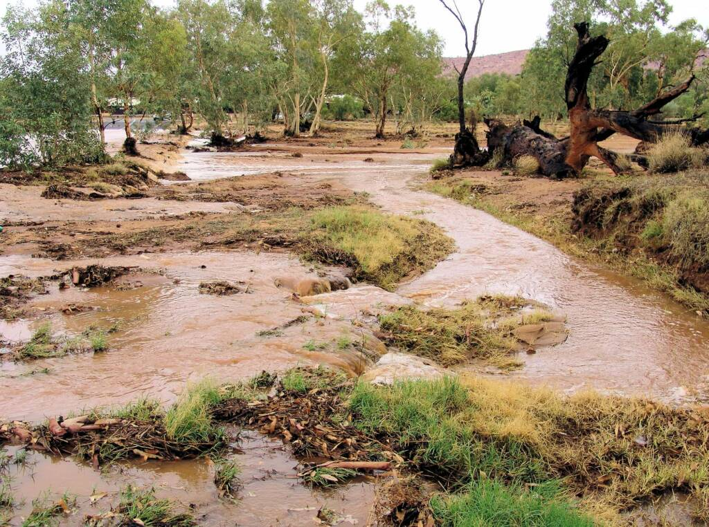 Todd River spilling across Tuncks Road, causing it's temporary closure, 8 Jan 2010
